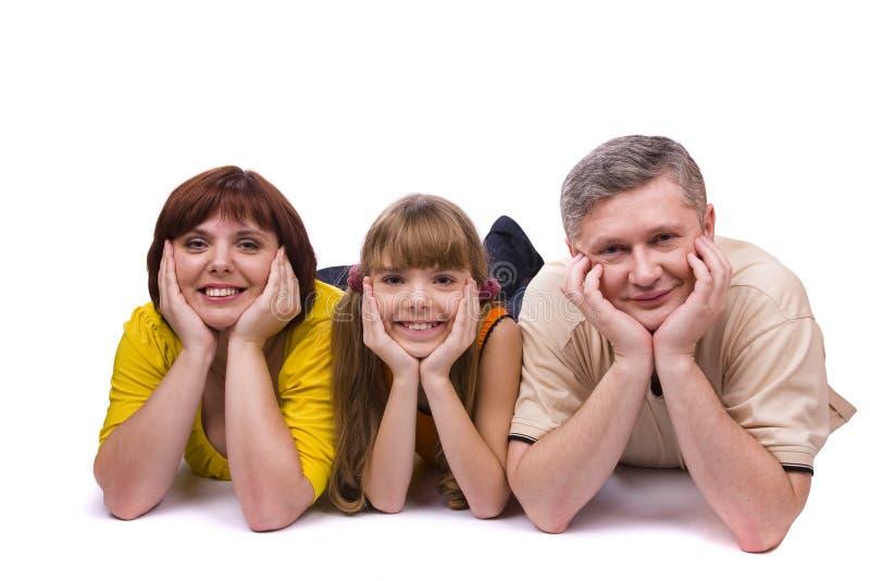 Glückliche Familie. Mutter, Vater und Tochter stockbilder