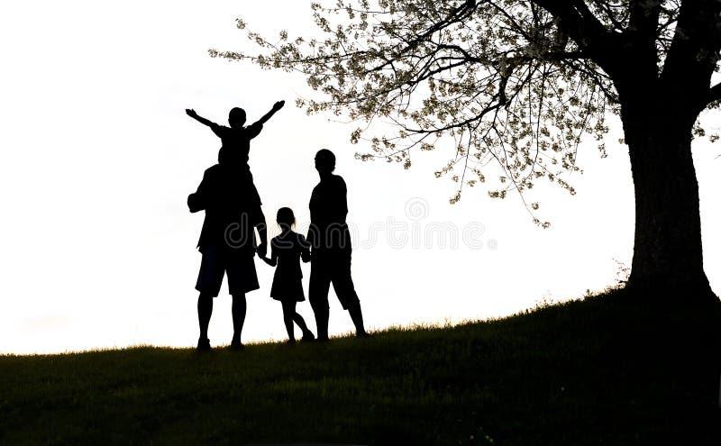 Glückliche Familie, Schattenbild stockbild