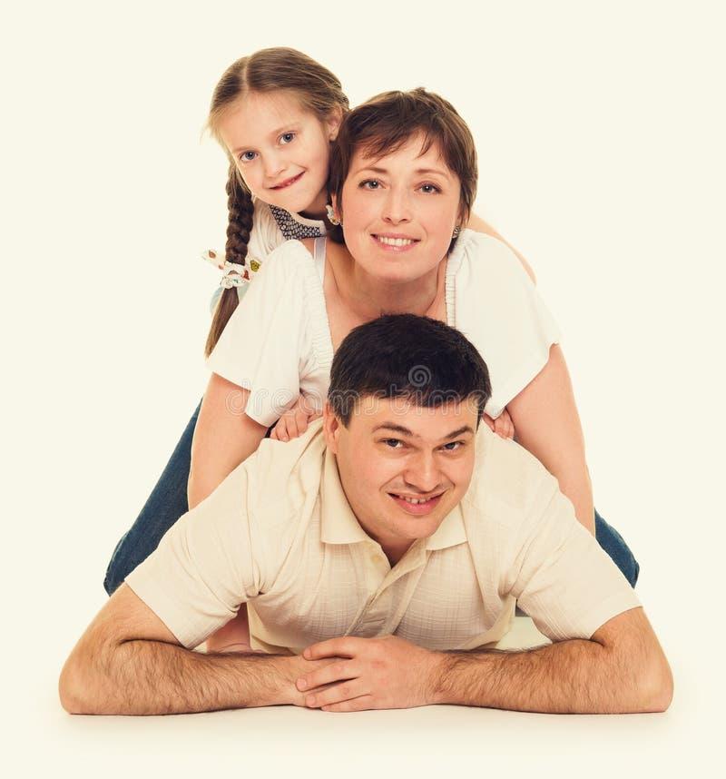 Glückliche Familienlüge, glückliches Konzept lizenzfreies stockfoto