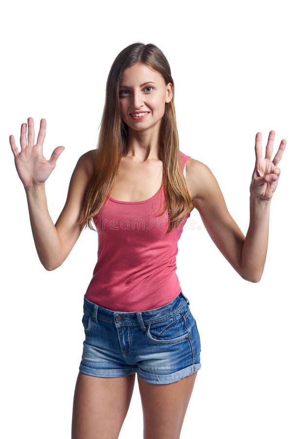 Glückliche Frau kurz gesagt acht Finger zeigend stockbild