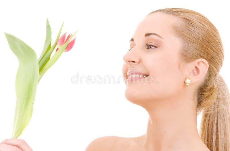 Glückliche Frau mit Blume stockfotos