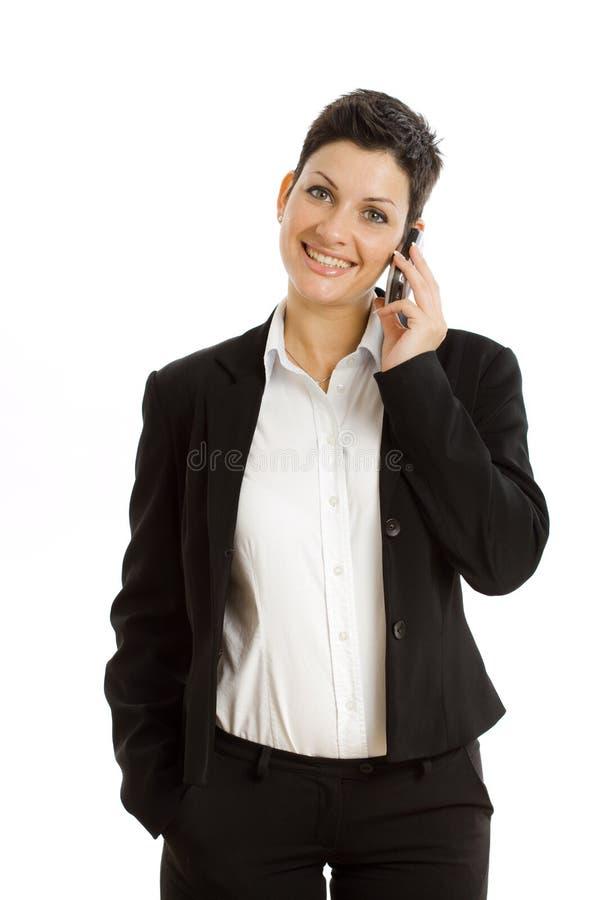 Glückliche Geschäftsfrau mit dem Mobiltelefon getrennt lizenzfreies stockfoto
