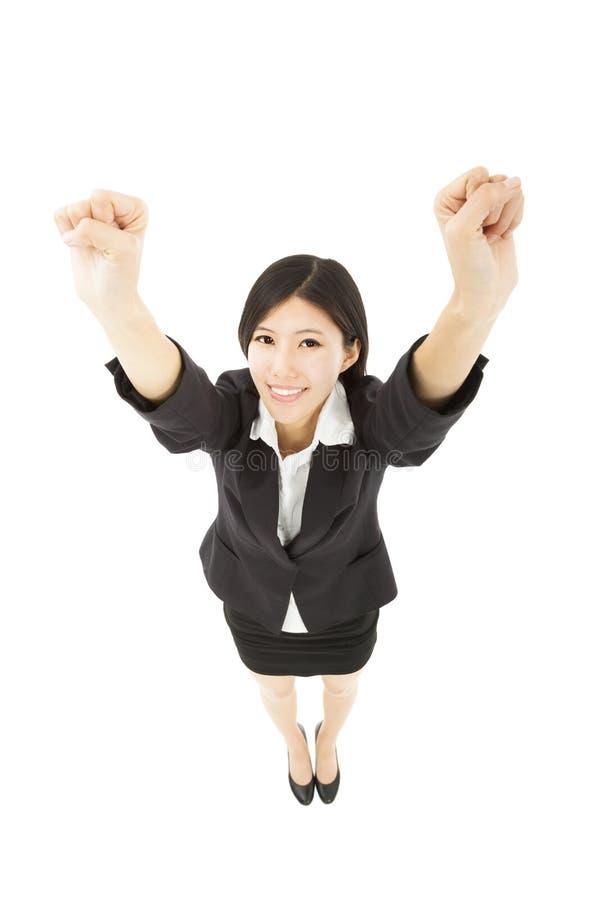 Glückliche Geschäftsfrau mit Erfolgsgeste lizenzfreie stockbilder