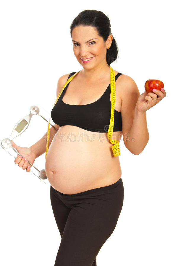 Glückliche gesunde schwangere Frau stockfotos