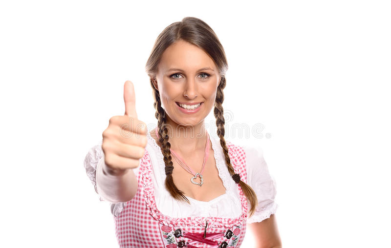 Glückliche junge Frau in einem Dirndlgeben Daumen oben stockbilder