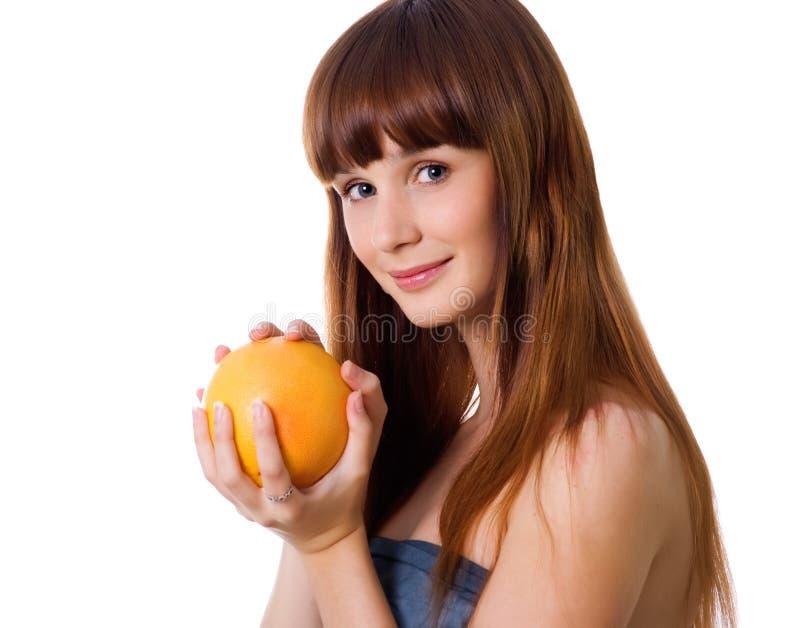Glückliche junge Frau mit Orange lizenzfreies stockbild
