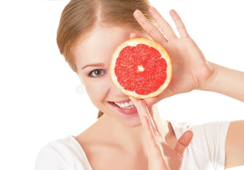 Glückliche junge Frau mit Pampelmuse Gesundes Essen lizenzfreie stockfotografie