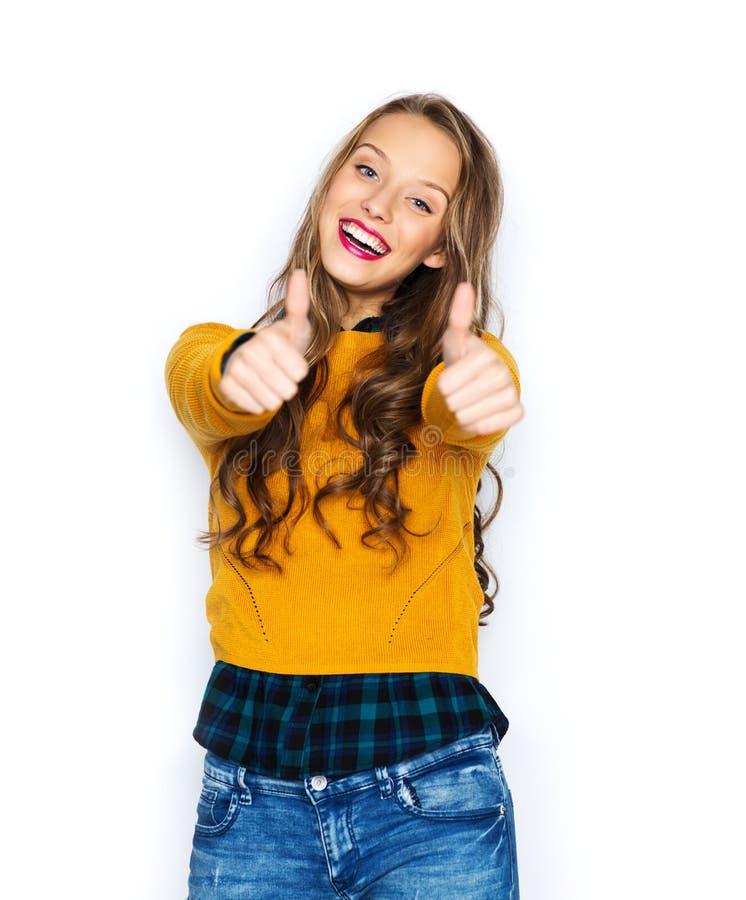 Glückliche junge Frau oder jugendlich Mädchen, die sich Daumen zeigen stockfotos