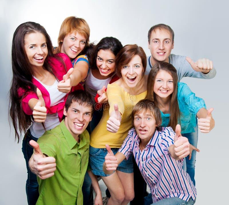 Glückliche junge Gruppe von Personen stockbilder