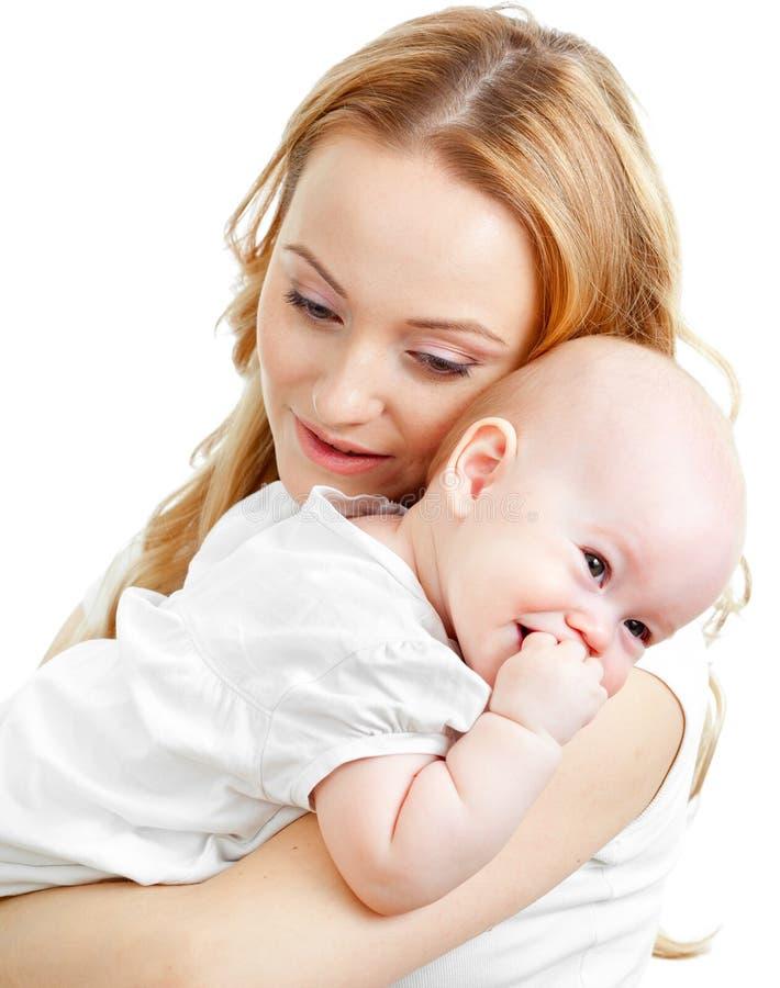 Glückliche junge Mutter und Schätzchen stockfotos