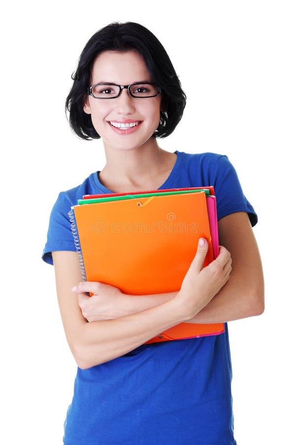 Download Glückliche Kursteilnehmerfrau Mit Notizbüchern Stockbild - Bild von gebildet, isolat: 27729319