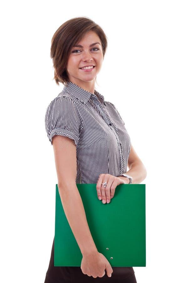 Glückliche lächelnde Geschäftsfrau mit Faltblatt lizenzfreie stockbilder