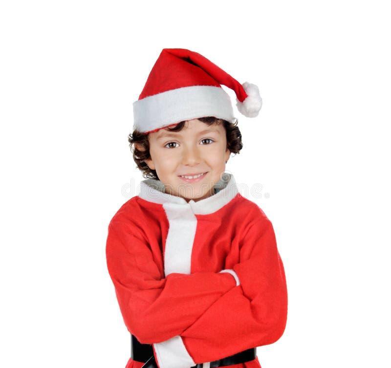 Glückliche lächelnde Kindtragende Weihnachtskleidung stockfotos