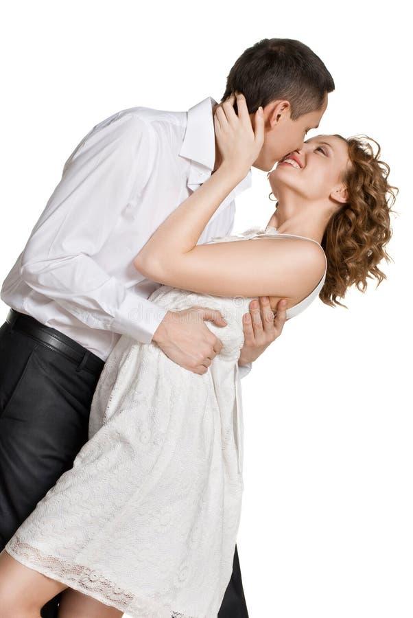 Glückliche lächelnde Paare in der Liebe. Lokalisiert über Weiß stockfoto