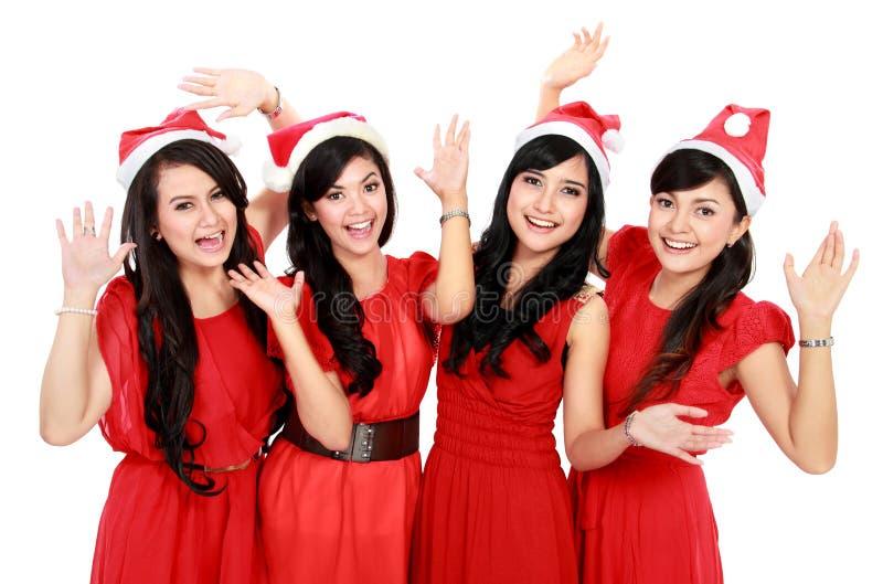 Glückliche lustige Leute mit Weihnachts-Sankt-Hut stockfotos