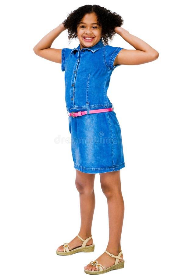 Glückliche Mädchen-Stellung stockfoto