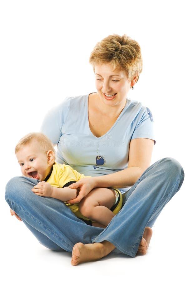 Glückliche Mutter mit einem Kind lizenzfreies stockfoto
