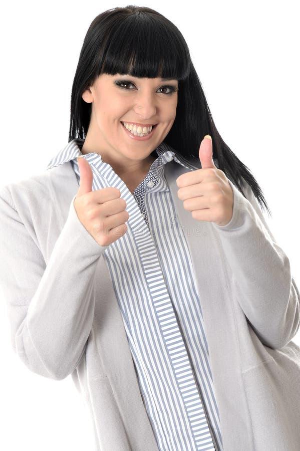 Glückliche nette erfreute positive Frau mit den Daumen oben lizenzfreie stockfotografie