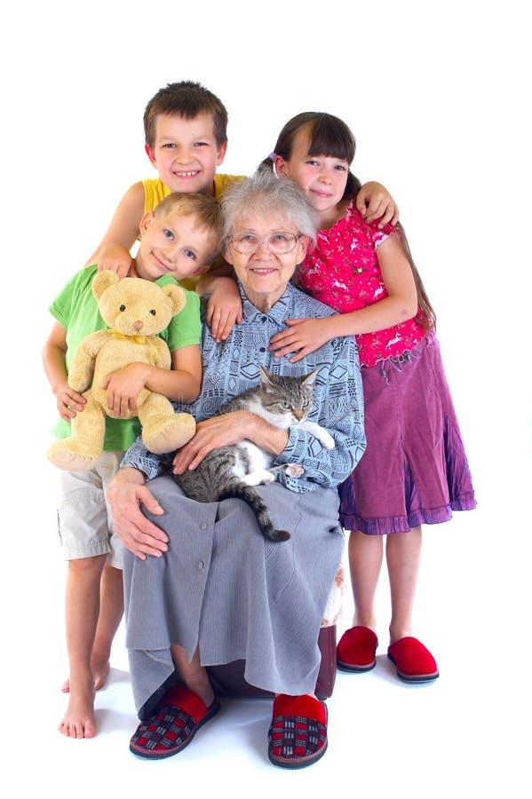 Glückliche Oma und Kinder lizenzfreie stockbilder