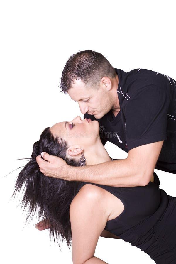 Glückliche Paare, die oben - weißen Hintergrund stehen stockbilder