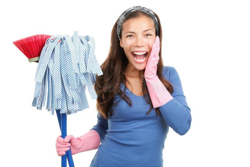 Glückliche Reinigungsfrau überraschte stockbild