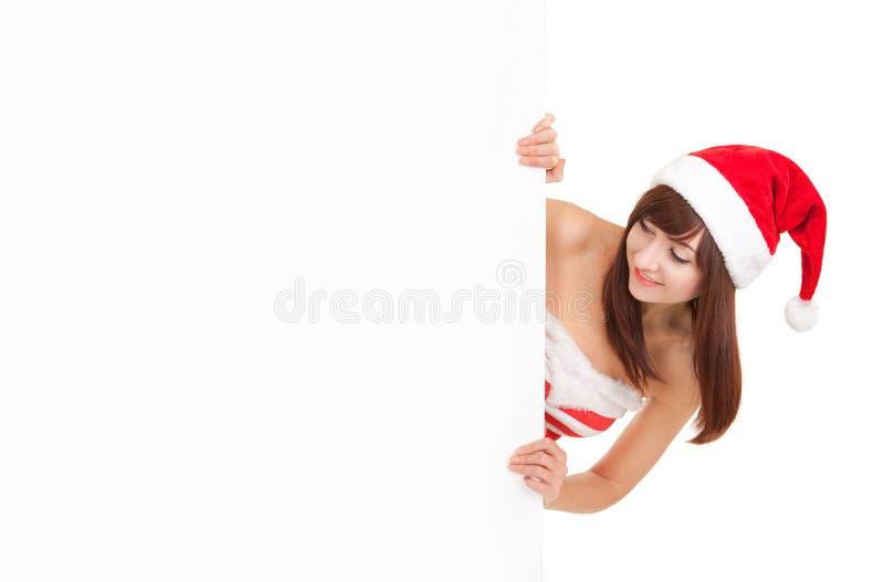 Glückliche Sankt-Frau mit dem weißen leeren Brett lokalisiert auf Weiß lizenzfreie stockfotos