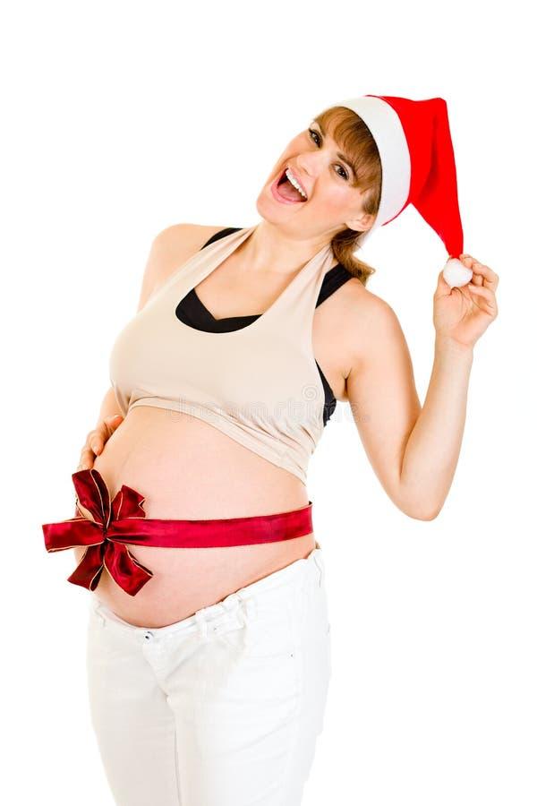Glückliche schöne schwangere Frau im Sankt-Hut lizenzfreie stockfotografie