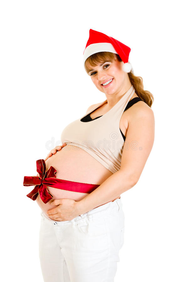 Glückliche schöne schwangere Frau im Sankt-Hut stockfotografie