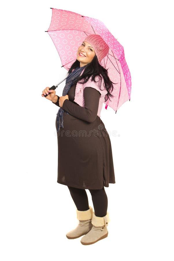 Download Glückliche Schwangere Frau Mit Regenschirm Stockbild - Bild von glück, freundlich: 27733825
