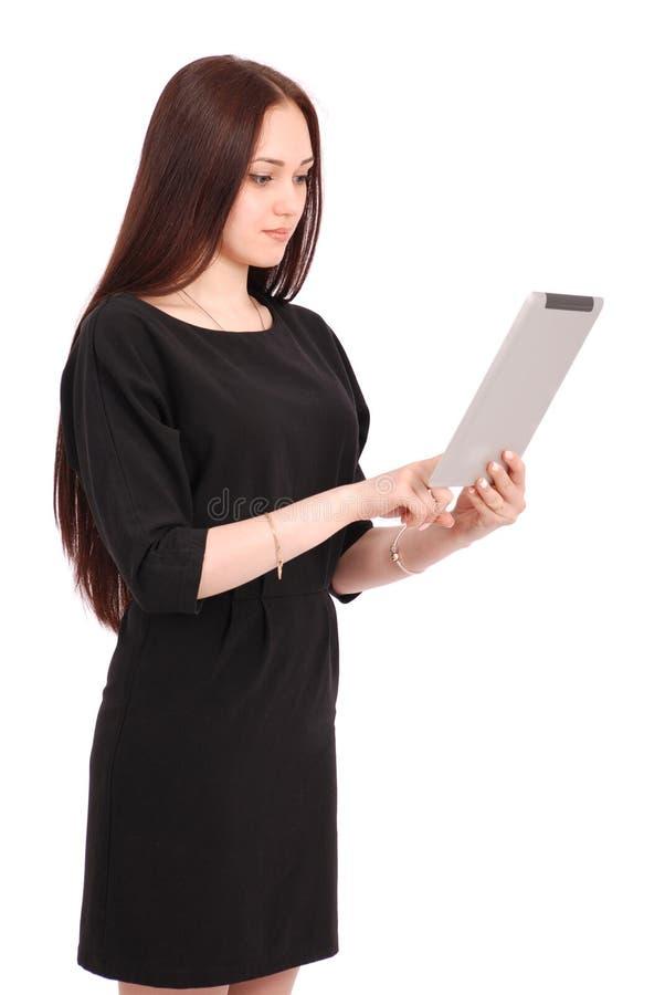 Glückliche Studentenjugendliche hält Tabletten-PC, seitlich zu stehen lizenzfreies stockbild