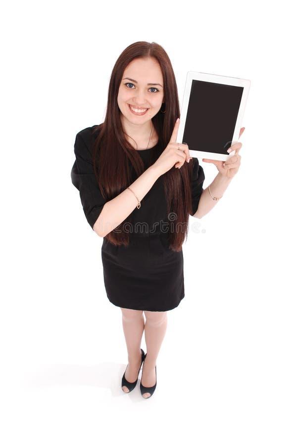 Glückliche Studentenjugendlicheansicht von oben genanntem und vom Zeigen einer Tablette stockbild