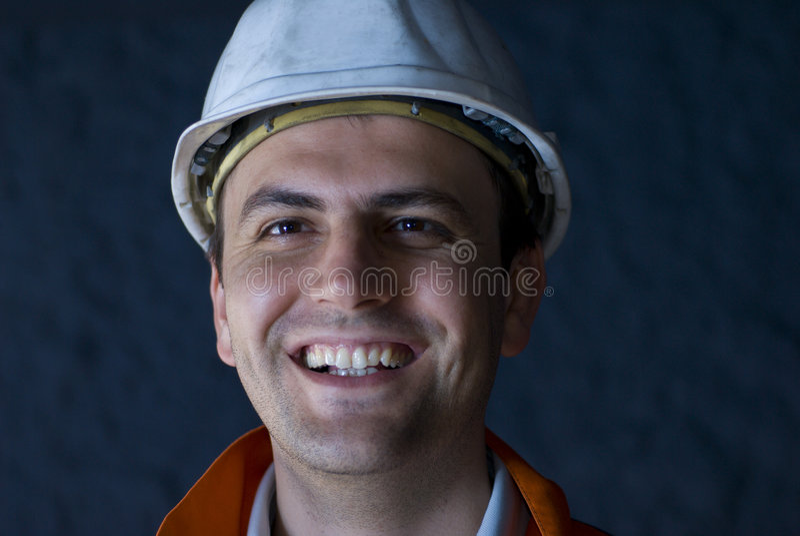 Glückliche Untertagearbeitskraft stockfotografie