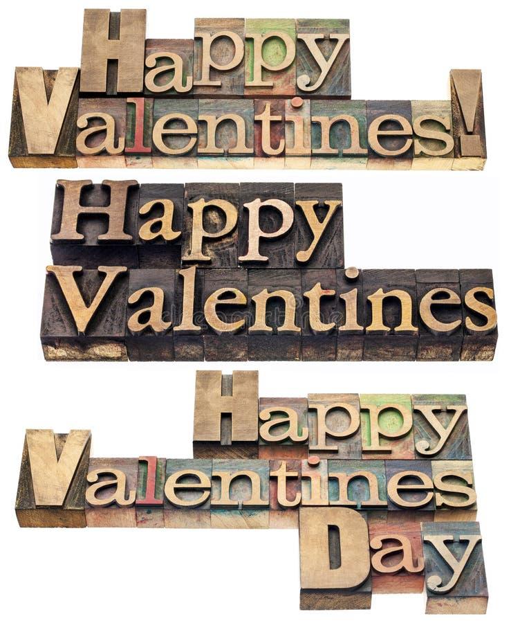Glückliche Valentinsgrüße im hölzernen Typen lizenzfreies stockbild