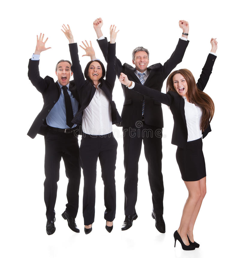 Glückliche Wirtschaftler, die in Freude springen stockfotos