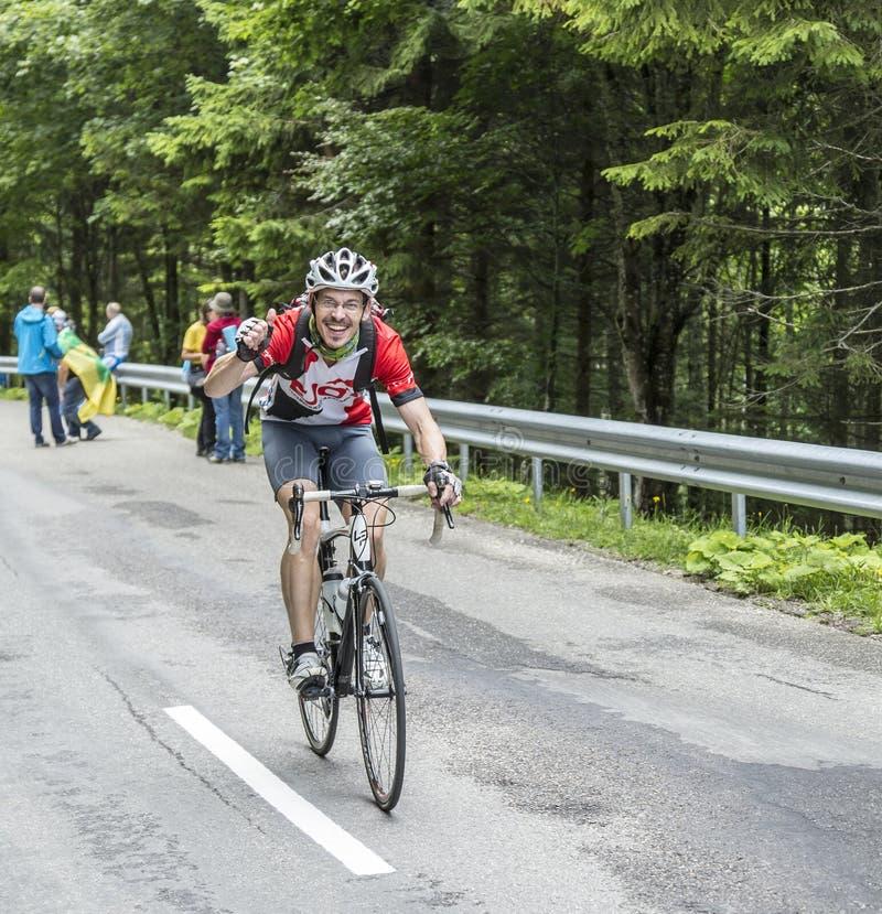 Glücklicher Amateurradfahrer stockbilder