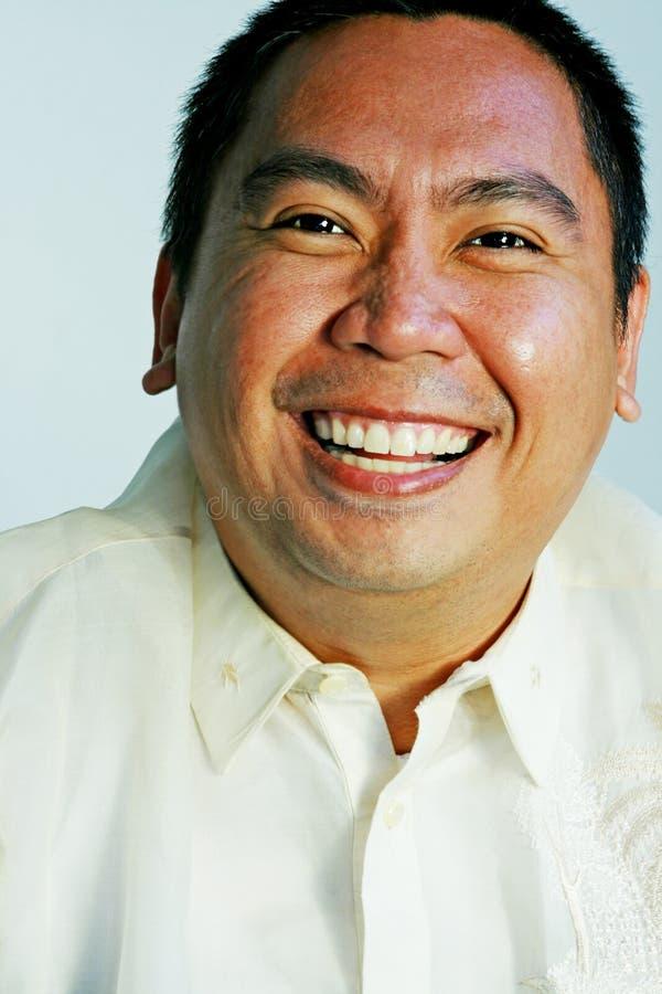 Glücklicher asiatischer Mann lizenzfreies stockbild