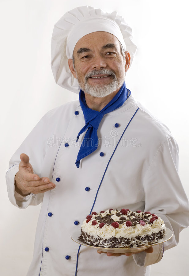 Glücklicher attraktiver Koch stockfoto