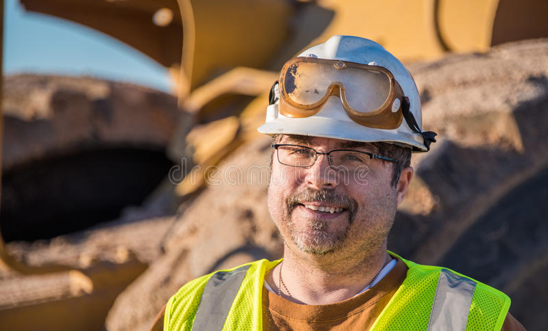 Glücklicher Bauarbeiter stockbilder