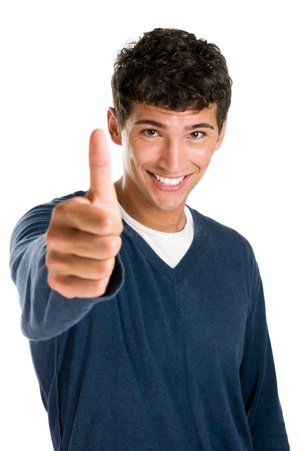 Glücklicher Daumen des jungen Mannes oben stockfotografie