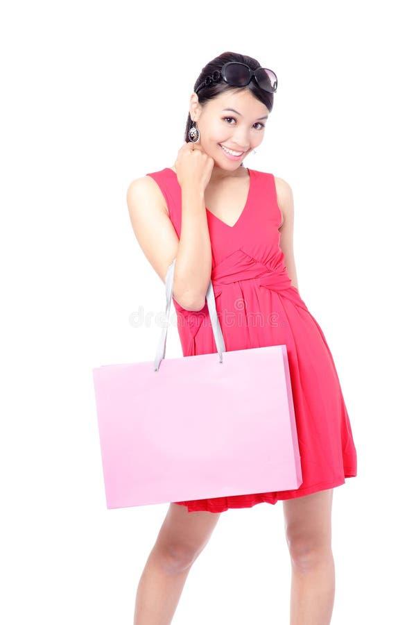 Glücklicher Einkaufen-Mädchen-Holdingbeutel lizenzfreie stockbilder