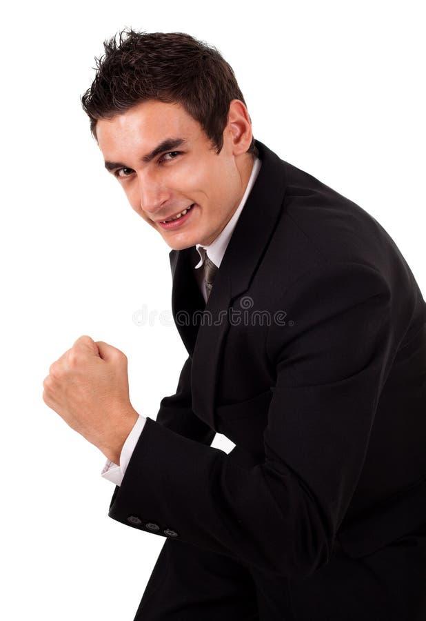 Glücklicher Energiegeschäftsmann mit seinen Armen angehoben lizenzfreies stockfoto