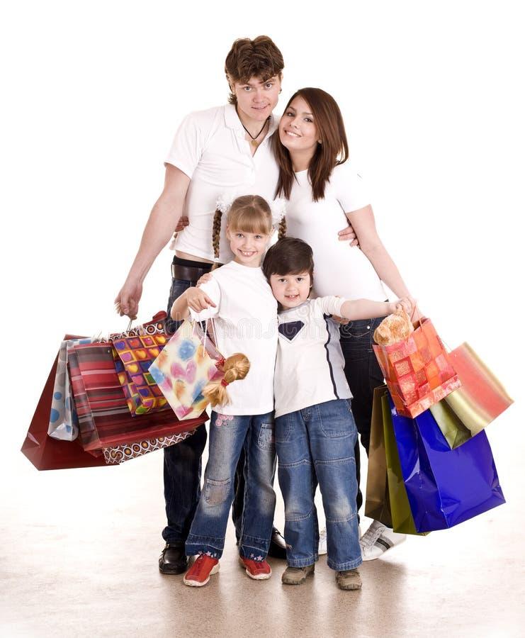 Glücklicher Familien- und Kindeinkauf. lizenzfreie stockfotos