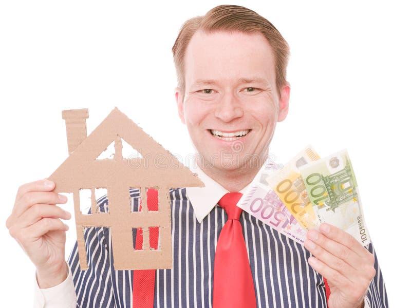 Glücklicher Geschäftshauseigentümer mit Geld lizenzfreies stockfoto