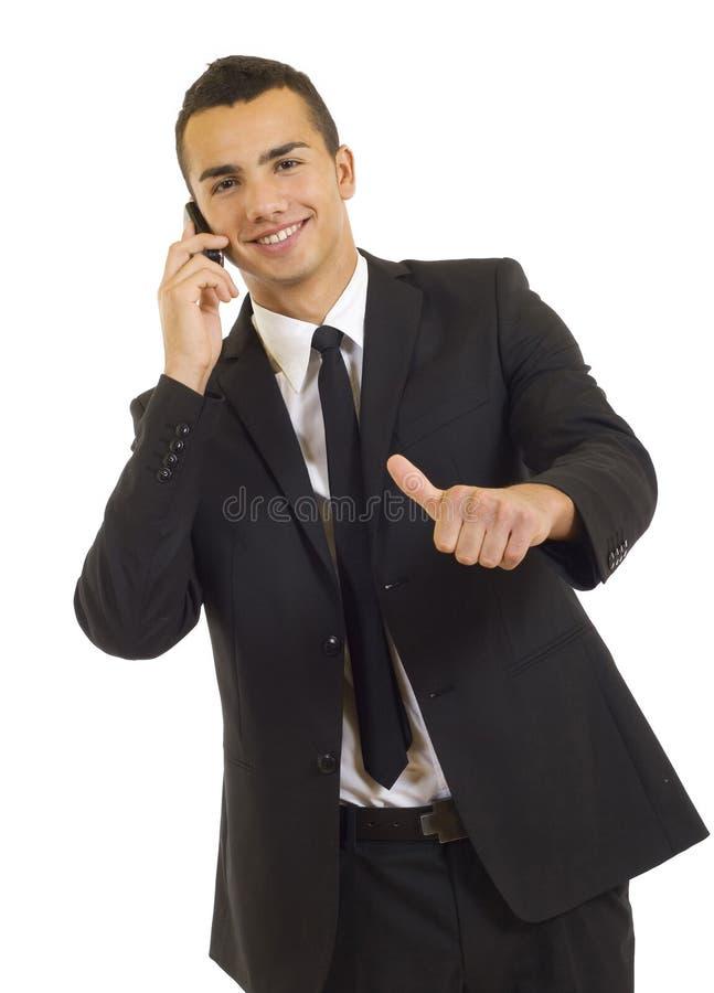 Glücklicher Geschäftsmann, der sich Daumen zeigt lizenzfreies stockfoto