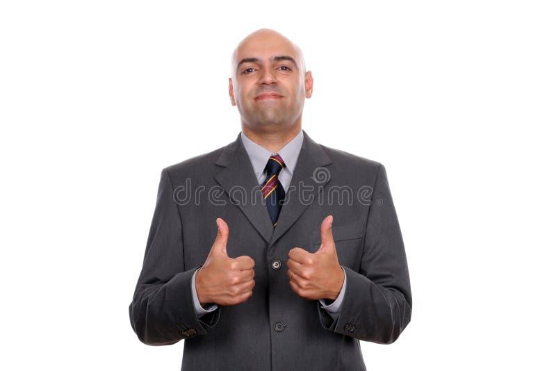 Glücklicher Geschäftsmann, der sich Daumen zeigt stockbild
