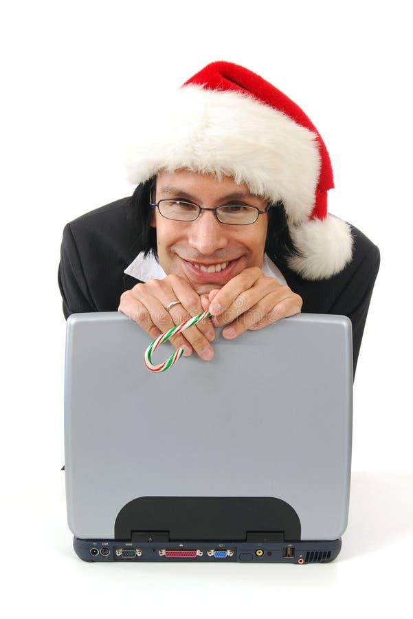 Glücklicher Geschäftsmann am Weihnachten stockfoto