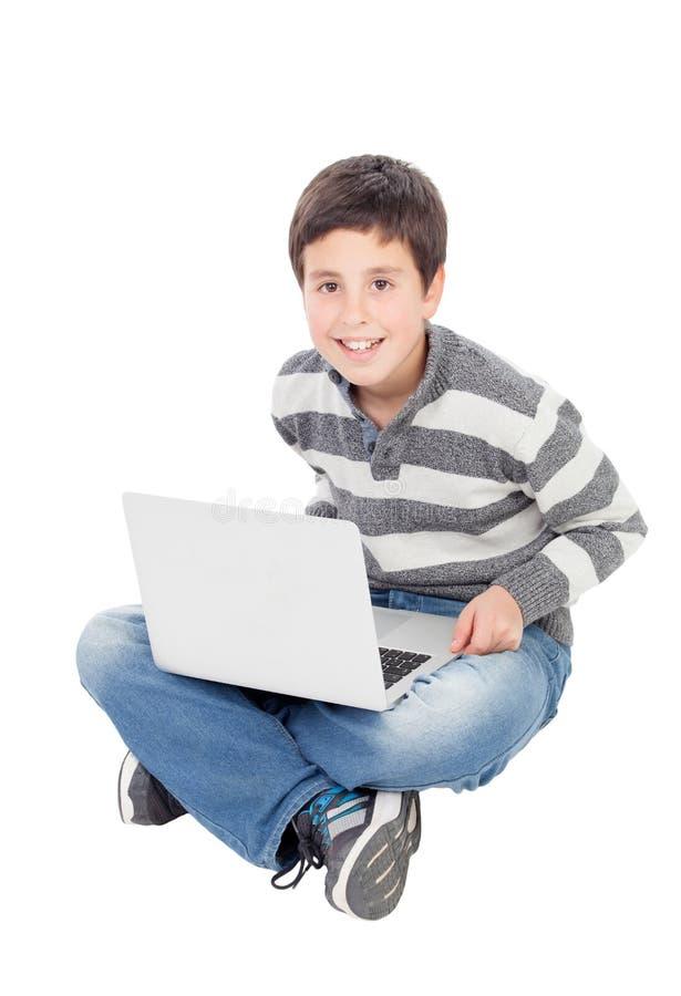 Glücklicher Junge mit dem Laptop lizenzfreie stockbilder