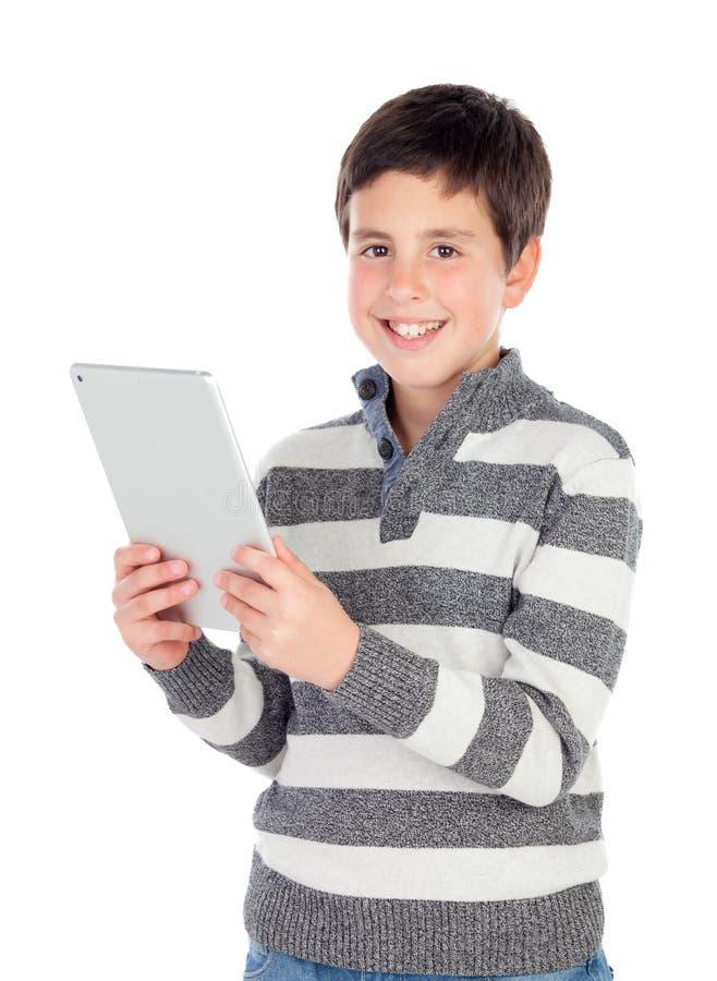 Glücklicher Junge mit einer Tablette lizenzfreie stockfotos