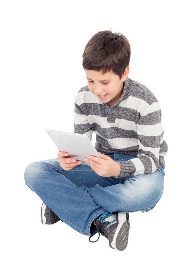 Glücklicher Junge mit einer Tablette lizenzfreie stockbilder