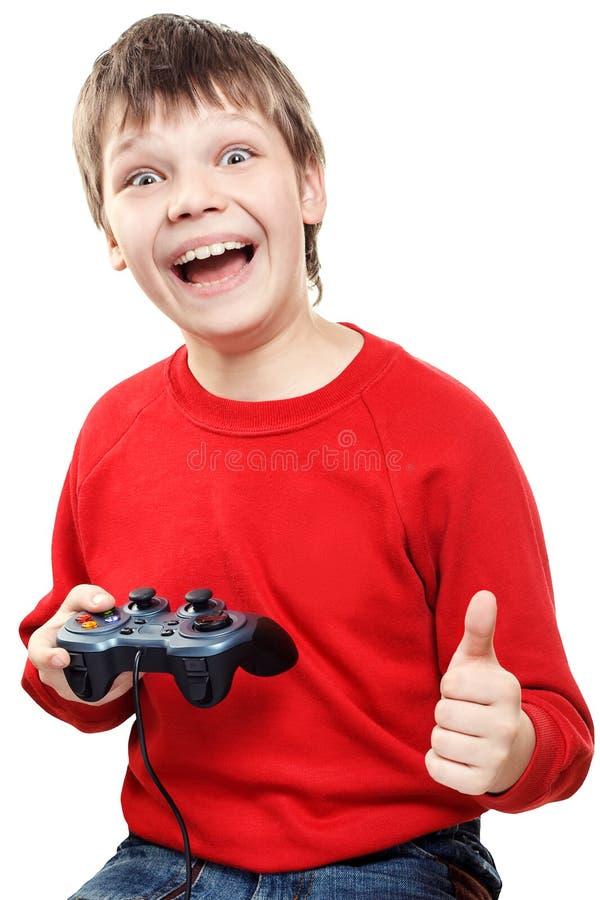 Glücklicher Junge mit gamepad in den Händen stockbild